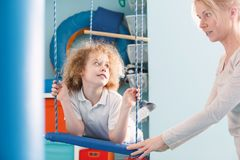 Boy on therapeutic swing Stock Photos