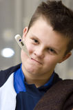 Boy with thermometer in mouth Stock Photo