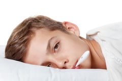 Boy with the thermometer preparing for treatment procedures. Boy with the flu and thermometer preparing for treatment procedures Stock Photography