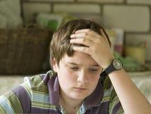 Boy thinking. A boy hardly solving homework Royalty Free Stock Photography