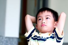 Boy thinking Stock Images