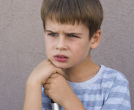 Boy thinking Stock Photography