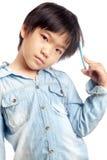 Boy thinking. Asian boy thinking isolated on white background Royalty Free Stock Images