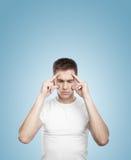 Boy thinking. On a blue background Stock Photos
