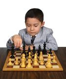 Boy thinking of chess move. Eight-year-old boy contemplating a chess move, white background Stock Images