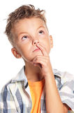Boy thinking. Cute young boy thinking on white background stock photo