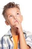 Boy thinking Stock Photo