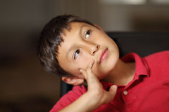 Boy thinking or day dreaming Royalty Free Stock Image