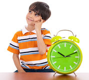 Boy thinking deeply. Near the clock Royalty Free Stock Images
