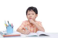 Boy thinking between doing homework Royalty Free Stock Photography