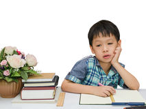 Boy thinking between doing homework Stock Photos