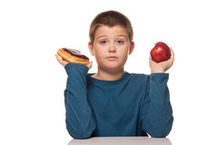 Boy thinking of a food choice Royalty Free Stock Image