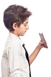 Boy thinking at health benefits of chocolate Stock Images