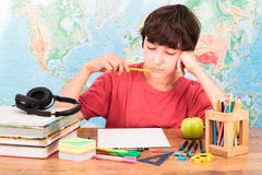 Boy thinking about his homework. Young boy thinking about his homework Stock Image