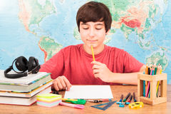Boy thinking about his homework Royalty Free Stock Image
