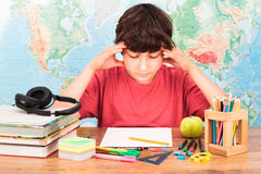 Boy thinking about his homework Stock Photo