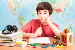 Boy thinking about his homework Stock Photos