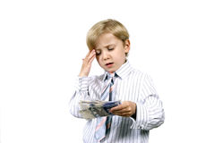Boy thinking about  money Royalty Free Stock Photo