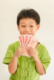 Boy thinking with holding Thai money Royalty Free Stock Photo
