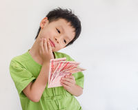 Boy thinking with holding Thai money Stock Photo