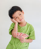 Boy thinking with holding Thai money Royalty Free Stock Images