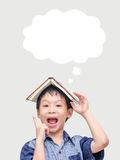 Boy thinking with idea bubble. Young Asian boy thinking with idea bubble over background Stock Images