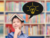 Boy thinking with light bulbs Stock Photography