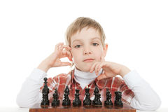 Boy thinking on next move Stock Photos
