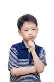 Boy thinking over white background Royalty Free Stock Image