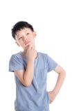 Boy thinking over white background Stock Photos
