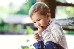Boy thinking at the park Stock Photography