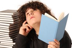 Boy thinking and reading a book royalty free stock photo