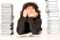 Boy thinking and reading a book Stock Images