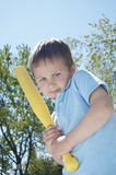 Boy Thinking About Swinging His Bat Royalty Free Stock Image
