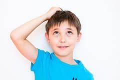 The boy thinks Royalty Free Stock Photo