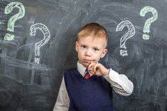 The boy thinks the question marks stock images