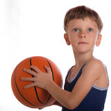 The boy threw a basketball ball two hands Royalty Free Stock Photography