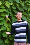 Boy throw up. The baseball ball in the park Stock Photo