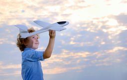 Boy throwing airplane royalty free stock photography