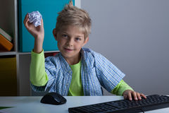 Boy throwing ball of paper Royalty Free Stock Photography