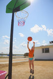 Boy throwing ball to basket Royalty Free Stock Photo
