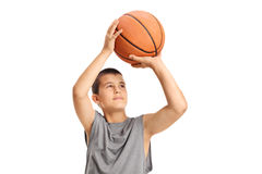 Boy throwing a basketball. Isolated on white background stock images
