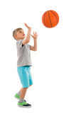 Boy Throwing Basketball. Photo Of Boy Throwing Basketball Over White Background royalty free stock photo