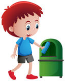 Boy throwing bottle in trashcan Stock Images