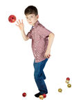 Boy throwing a Christmas tree ball on white background. Royalty Free Stock Images