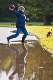 Boy Throwing A Football Royalty Free Stock Photos