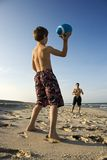 Boy throwing football with dad. stock image