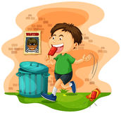 Boy throwing icecream bag on the ground Stock Images