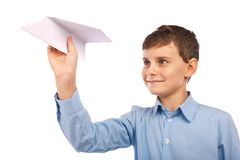 Boy throwing a paper plane Stock Photo