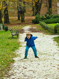 Boy throwing pebbles Stock Photography